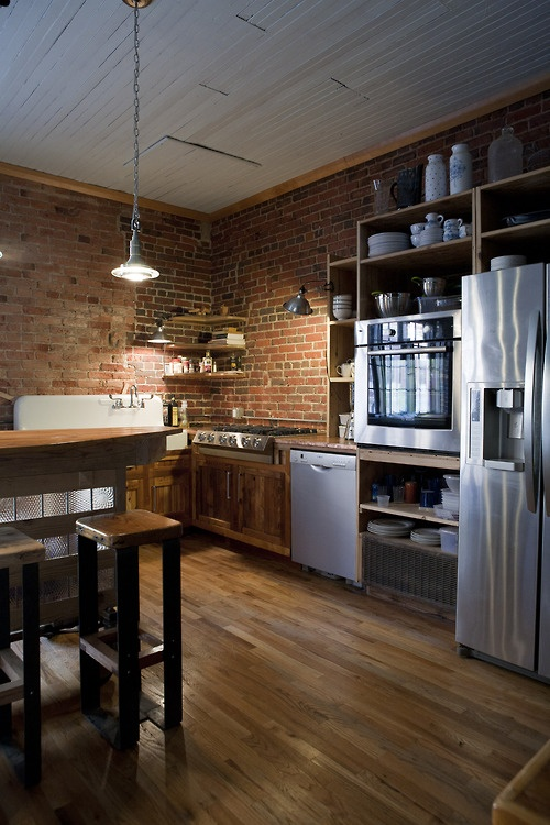 Home interiors traditional kitchen with brick walls 2013 for 2 wall kitchen designs