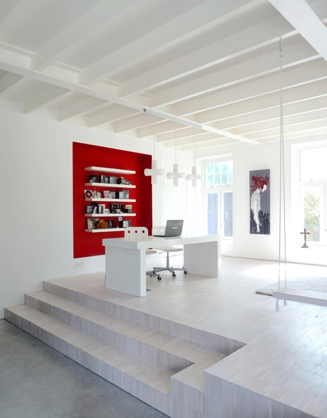 Picture of working desk and red part of the wall behind