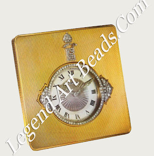 A gold travelling clock, part of a travelling suite made for the Maharaja of Baroda, by Cartier London, 1947.