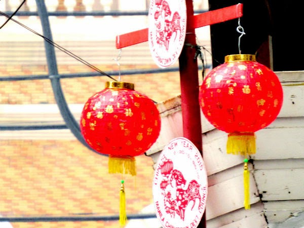 Chinese lanterns hung over street posts along Ongpin St.