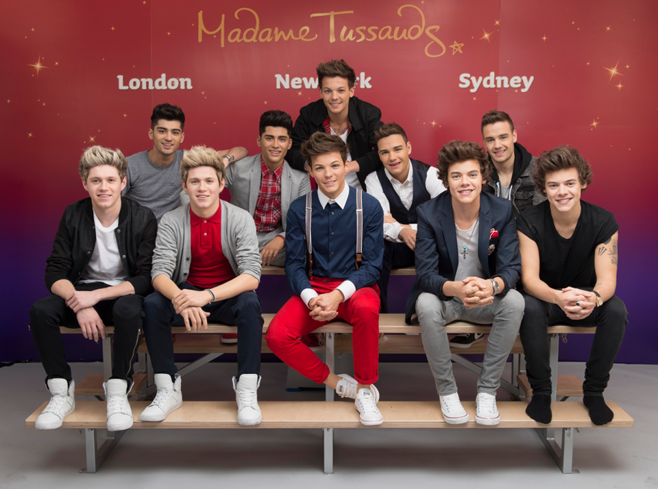 The band took a sneak peek at their own wax figures on Tuesday, before