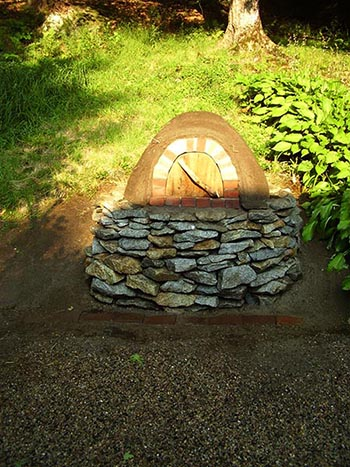 Our handmade outdoor 'beehive' bake oven~