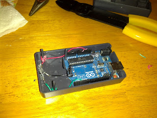 Open Arduino enclosure, showing the Arduino board nested in position and the IR decoder glued in place.