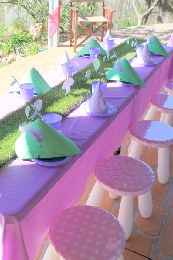 fairy party table, pink, purple, party hats, printable decorations, grass table runner, paper straws, polka dots, fairy decorations