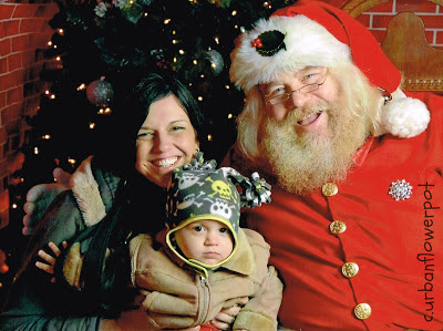 creating christmas memories with your toddler, first picture with santa, love park christmas village