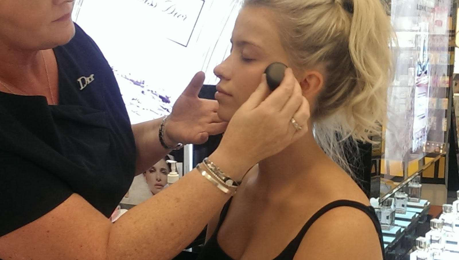 Girl Having Foundation Applied At