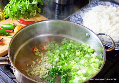 Add rice, stirring constantly and breaking up chunks. Add salt and ...