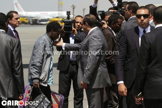 Sisi receives Ethiopians returning from Libya at Cairo Airport