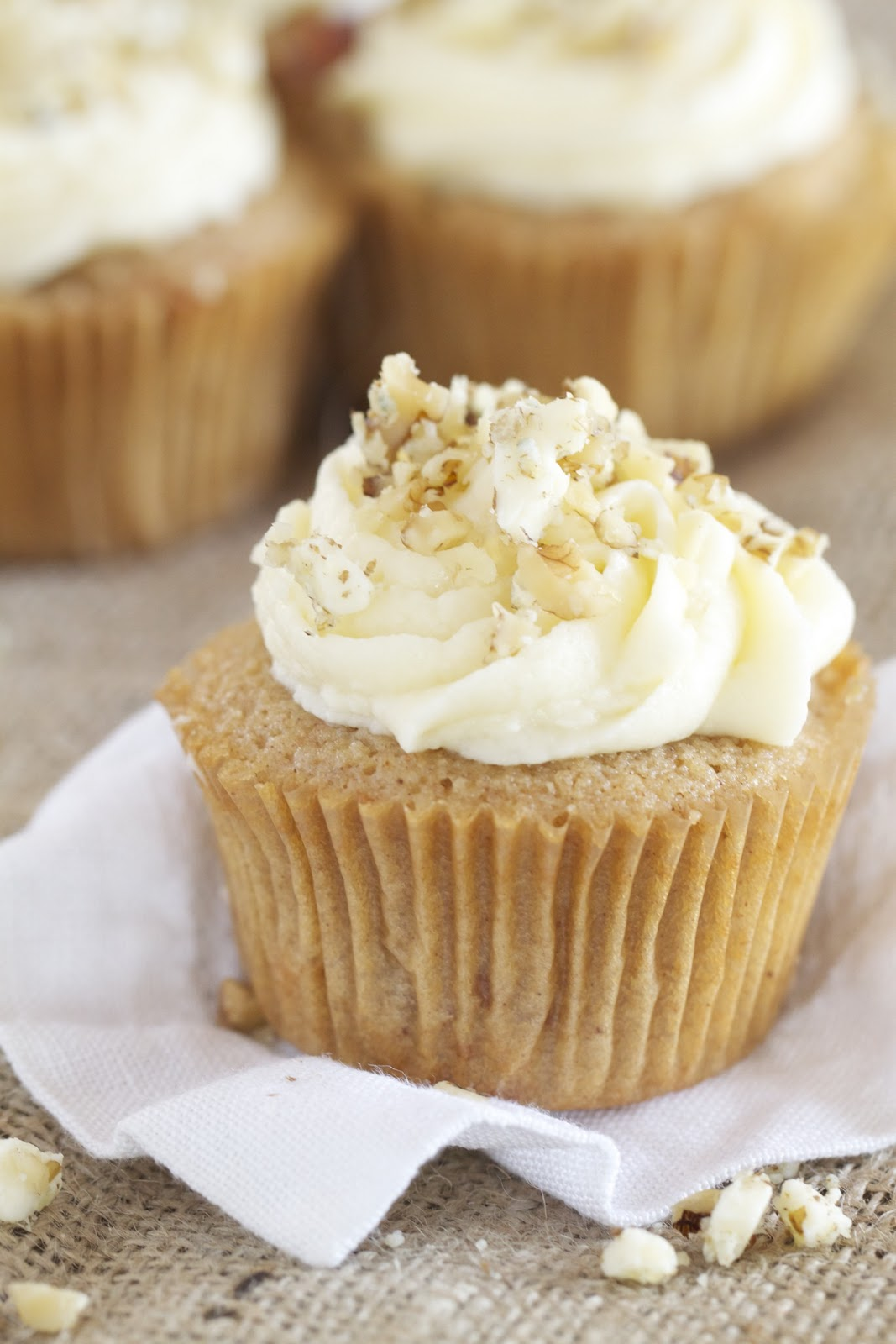 Apple-Spice Cupcakes with Vanilla Frosting Sprinkled with Walnuts and ...