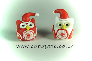 Red and White Christmas Owls 2012 by Cara Jane. Small red and white owl ornaments with santa hats