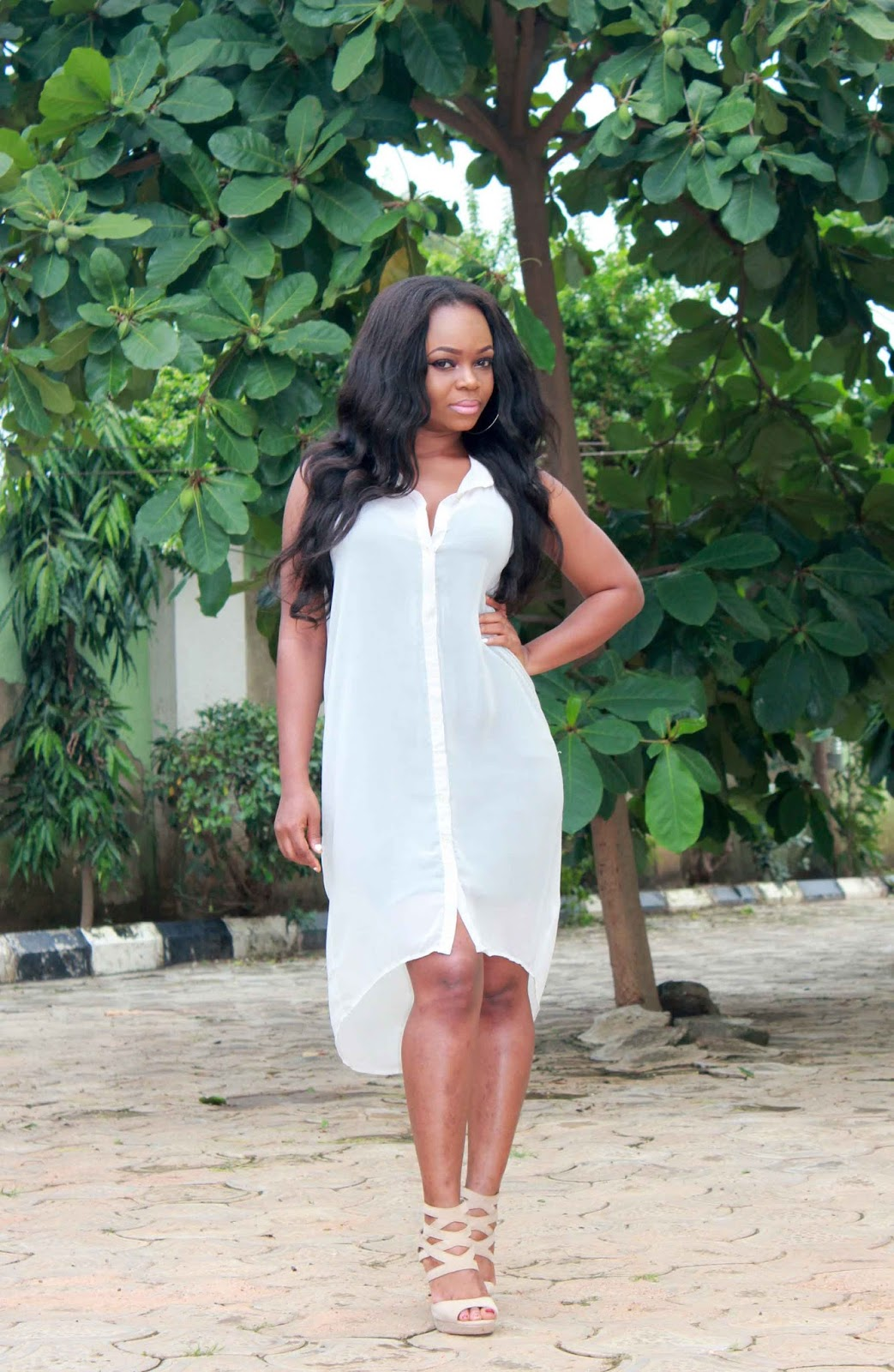 cream colored shirt dress with strappy sandals from Jumia