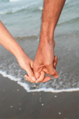 holding hands on beach - Does Sex Really Complicate and Destroy Relationships