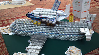 space shuttle made of canned goods on a 747 made from cans