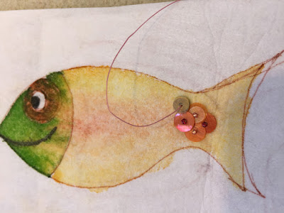 Starting to stitch the first Happy Fish by Karen Williams