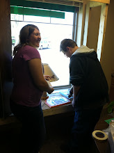 4-H Members Installing a Window Display at the Library.