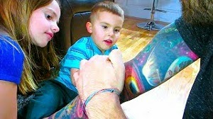 Kids inspecting tattoos (Video)