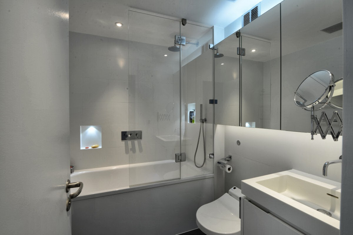 Thomson brothers at the barbican barbican tower flat kitchen installing a new kitchen bathroom and showerwc in this tower flat a false ceiling was installed in some areas to allow for inset spot lighting mozeypictures Image collections