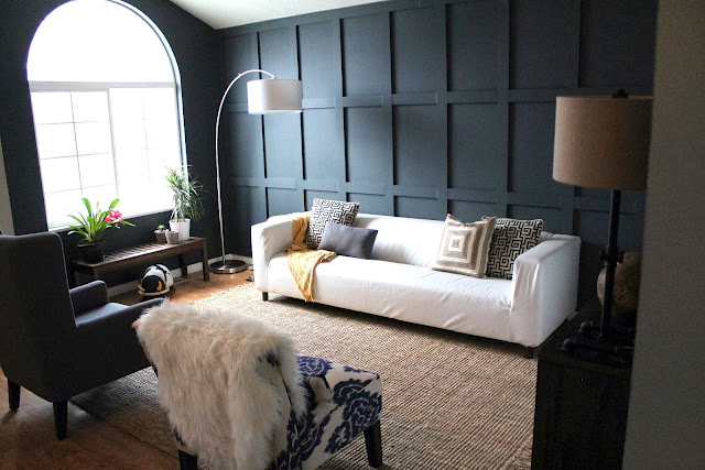 DIY living room Chris Loves Julia black paneled wall modern