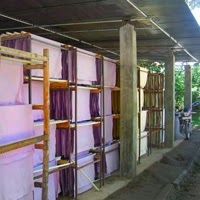 handmade paper sheets drying in shade