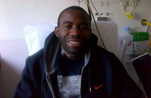 Fabrice Muamba smiles in hospital bed
