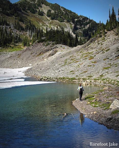 hiker glacier tarn