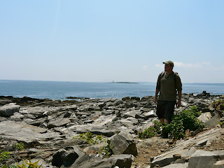 hiker strolls along Seashore Ave