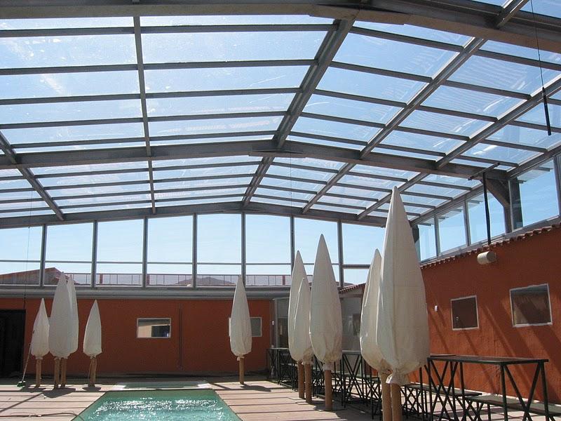 Porche de techo de vidrio cerramientos y cubiertas para for Estructuras de hierro para casas