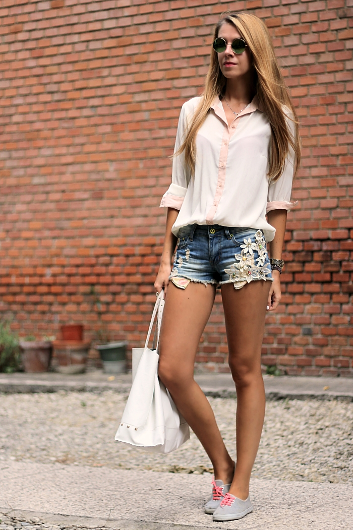 denim shorts, casual summer outfit, white shirt, roung mirror sunglasses, white bag, sneakers