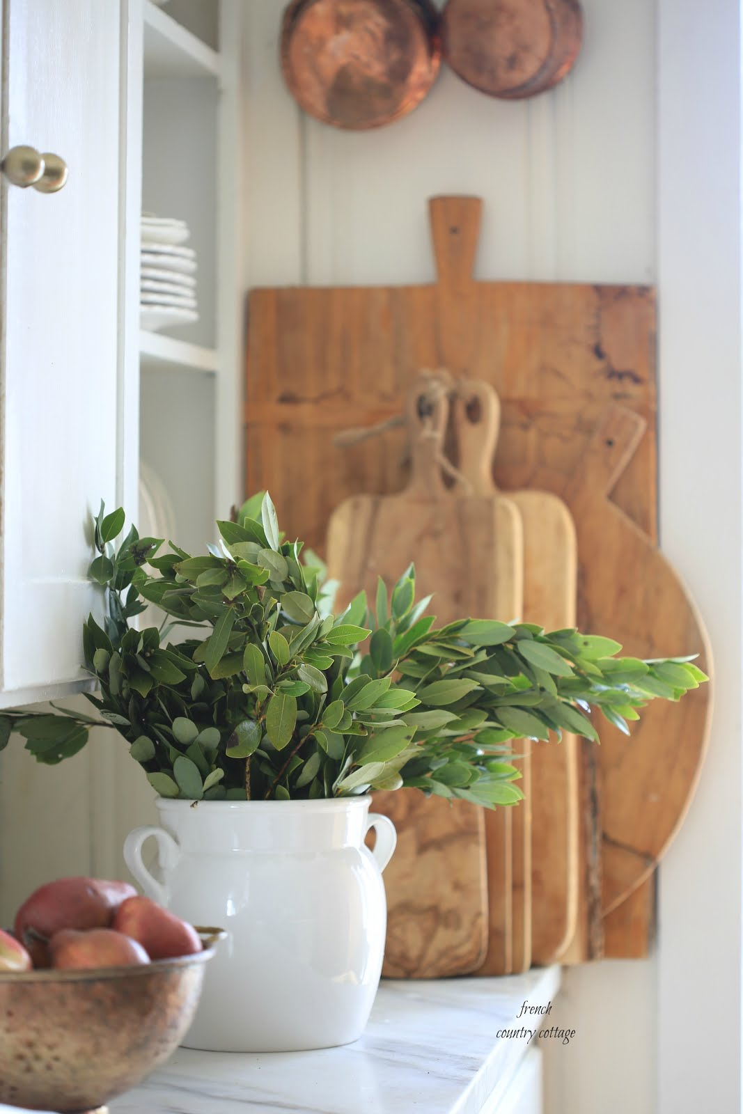 Courtney at french country cottage decorated the kitchen - Stack Of Breadboards In Kitchen