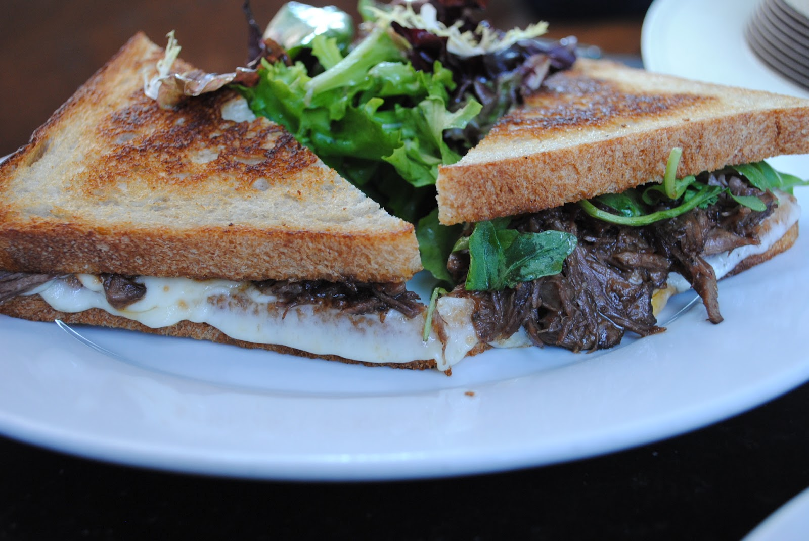 grilled cheese short rib sandwich with arugula, smoked maasdam cheese ...