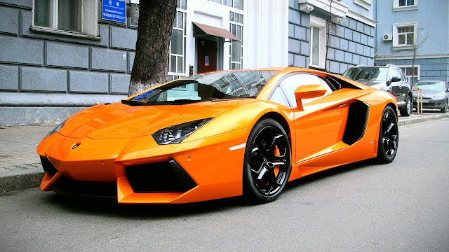 Orange lamborghini city HD Wallpaper