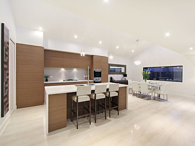 Picture of modern kitchen with brown furniture and kitchen island with three bar chairs