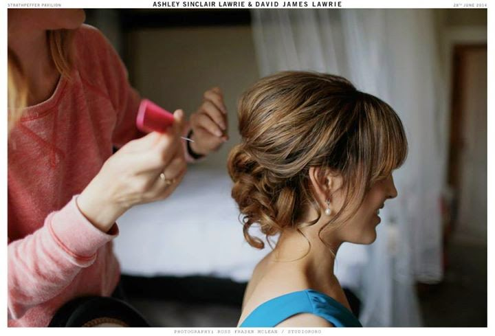 bridesmaid wears her hair in a soft voluminous style with soft curls