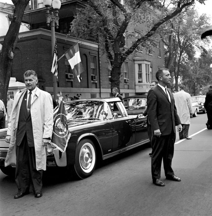 SAIC BEHN, SA JOHNSEN, AND OTHERS SURROUND JFK'S LIMO