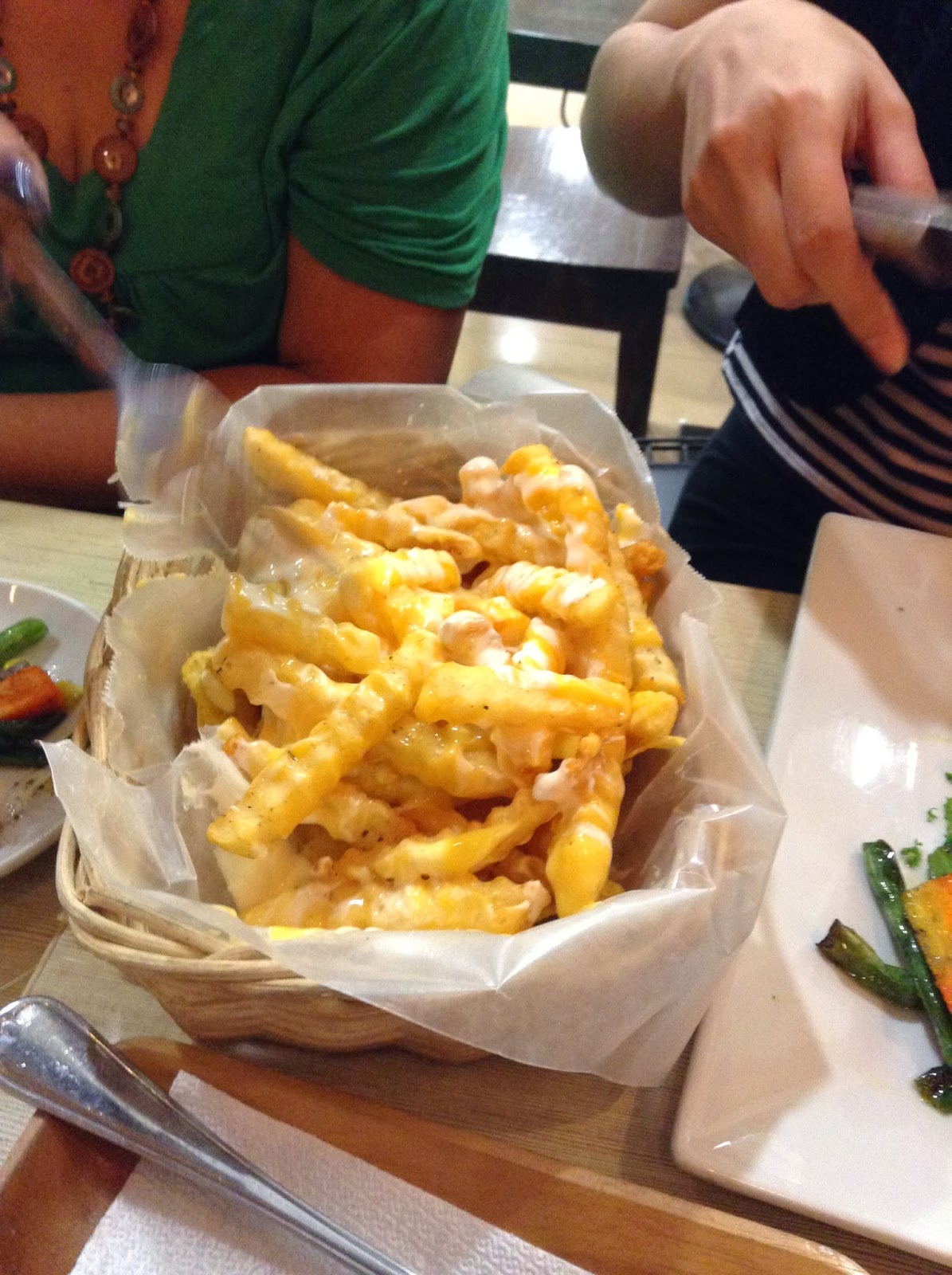 Eating Cheesy Nachos and fries
