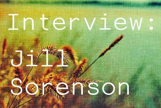 Image description: faded picture of a field with a close up on a wheat-like plant. The words Interview: Jill Sorenson on white on the foreground.