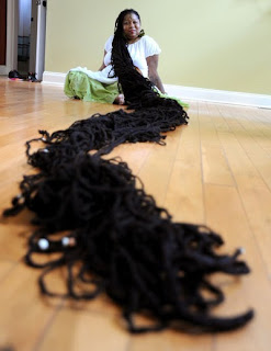 World's longest dreadlocks could leave woman paralyzed