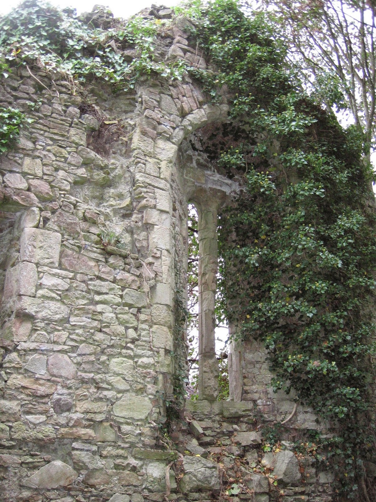 Catholic church ruins next to graveyard at Castletown Conyers in County Limerick Ireland