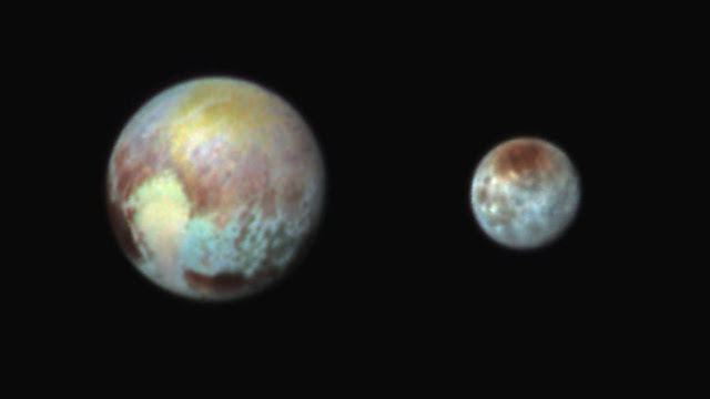 This July 13, 2015, image of Pluto and Charon is presented in false colors to make differences in surface material and features easy to see. It was obtained by the Ralph instrument on NASA's New Horizons spacecraft, using three filters to obtain color information, which is exaggerated in the image. These are not the actual colors of Pluto and Charon, and the apparent distance between the two bodies has been reduced for this side-by-side view.  The image reveals that the bright heart-shaped region of Pluto includes areas that differ in color characteristics. The western lobe, shaped like an ice-cream cone, appears peach color in this image. A mottled area on the right (east) appears bluish. Even within Pluto's northern polar cap, in the upper part of the image, various shades of yellow-orange indicate subtle compositional differences.   The surface of Charon is viewed using the same exaggerated color. The red on the dark northern polar cap of Charon is attributed to hydrocarbon materials including a class of chemical compounds called tholins. The mottled colors at lower latitudes point to the diversity of terrains on Charon.  This image was taken at 3:38 a.m. EDT on July 13, one day before New Horizons' closest approach to Pluto.   Credit: NASA/Johns Hopkins University Applied Physics Laboratory/Southwest Research Institute