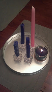 three purple candles and one pink advent candle