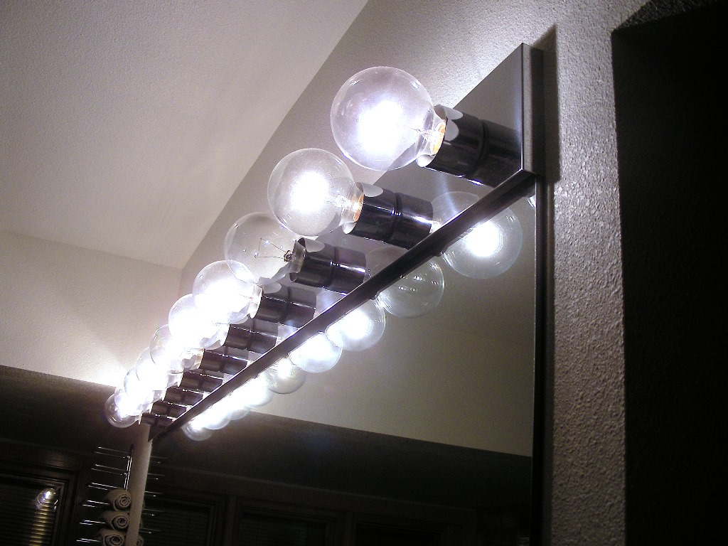 One Burned Out Bulb In A Row Of Ten Old Fashioned Incandescent Lightbulbs  Over Bathroom