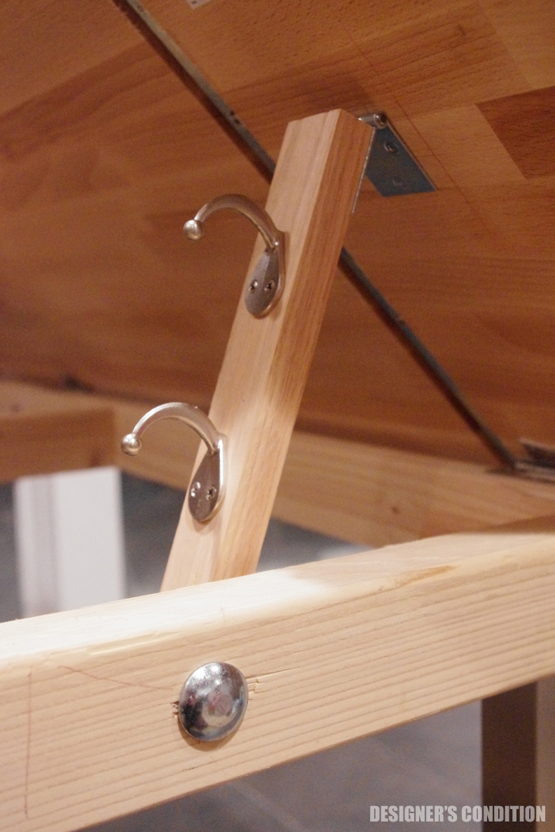 Coat Hooks On A 1x2 Fastened To The Table With A Hinge