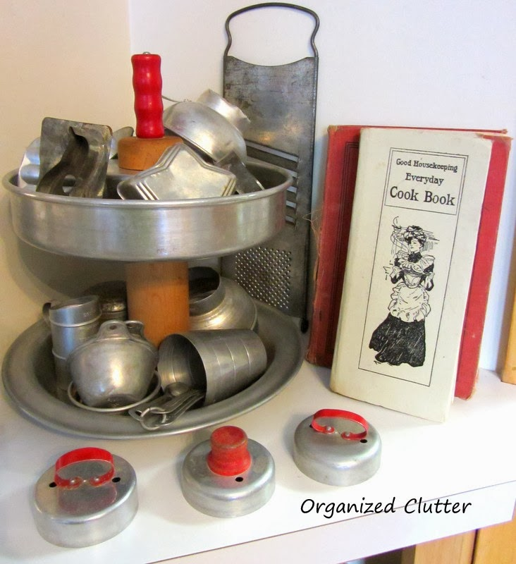 A Re-purposed Kitchen Ware Tiered Stand www.organizedclutterqueen.blogspot.com