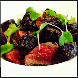 Pan-seared pigeon breast with roast apples, black pudding & cider reduction