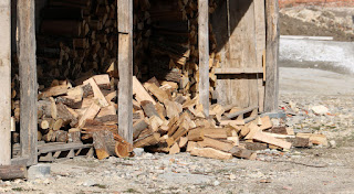 The front stack of wood fell over