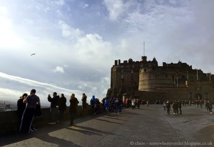 tourists gather outside the famous Edinburgh Castle