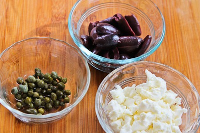 Mediterranean Salad with Hummus Dressing, Olives, Capers, and Feta ...