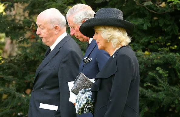 Prince Charles, Prince of Wales, and Camilla, Duchess of Cornwall make their way to the burial plot following the funeral of Deborah, Dowager Duchess of Devonshire at St Peter's Church, Edensor on 02.10.2014 in Chatsworth, England.