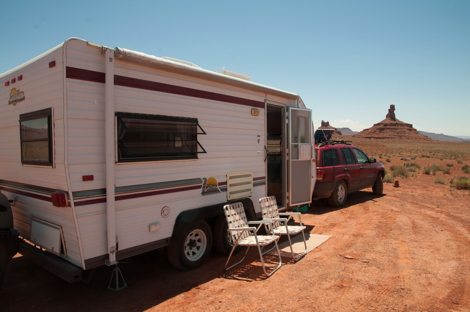 A view of a travel trailer at a campsite in Southern Utah, with a spire visible in the background