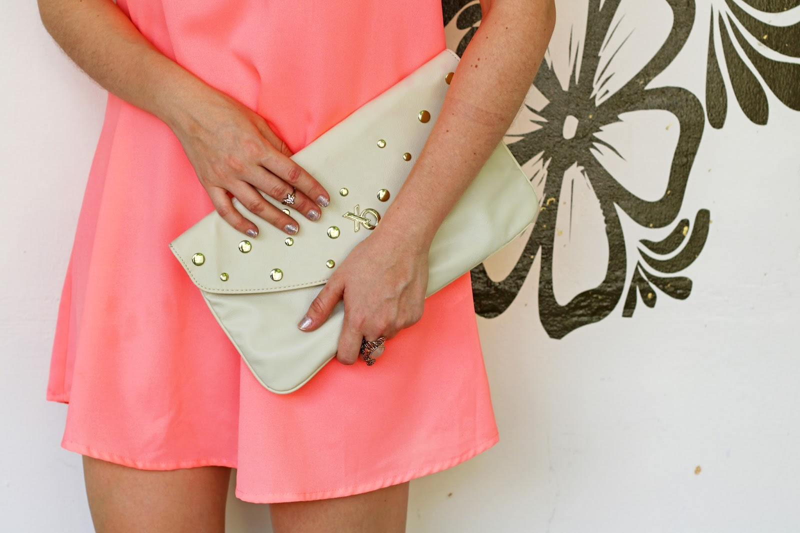 This studded Xoxo clutch goes with just about everything!